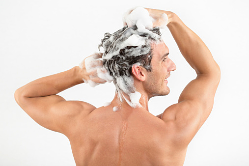 Man washing hair with shampoo